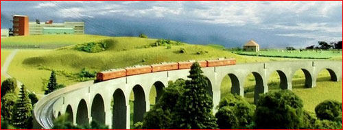 T-Gauge train crossing viaduct
